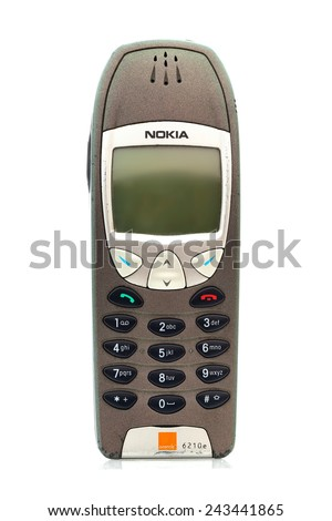 SWINDON, UK - JANUARY 12, 2015: Old well worn vintage Nokia 6210 Mobile Phone on a White Background. Nokia is a Finnish communications and information technology corporation.  - stock photo