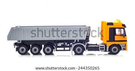 SWINDON, UK - JANUARY 15, 2015: Yellow Tipper Truck on a White Background - stock photo