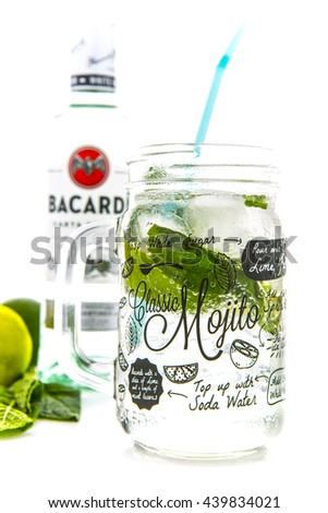 SWINDON, UK - JUNE 20, 2016: Classic Mojito cocktail in a Kilner Mason Jar with a bottle of Bacardi isolated on a white background - stock photo