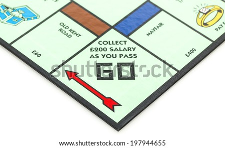 SWINDON, UK - JUNE 11, 2014: English Edition of Monopoly showing Pass Go,  The classic trading game from Parker Brothers was first introduced to America in 1935.  - stock photo