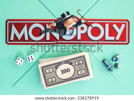 SWINDON, UK - JUNE 11, 2014: English Edition of Monopoly showing The Logo,  The classic trading game from Hasbro was first introduced to America in 1935.  - stock photo