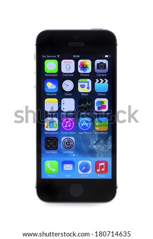 SWINDON, UK - MARCH 9, 2014: New Apple iPhone 5S in a box over a White Background. - stock photo