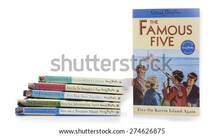 SWINDON, UK - MAY 3, 2015: Collection of Famous Five Books writen by Enid Blyton on a white background with copy space. - stock photo
