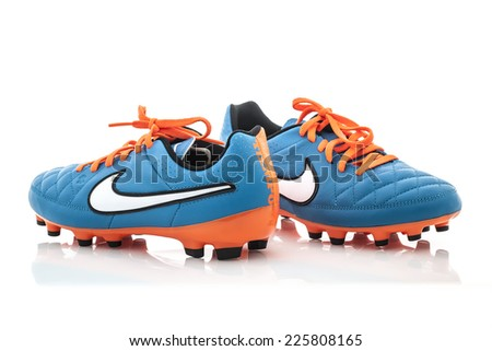 SWINDON, UK - OCTOBER 25, 2014: A Pair of Nike Football shoes on a White Background - stock photo