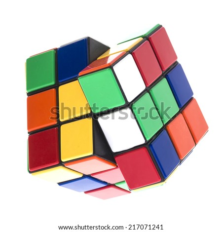 SWINDON, UK - SEPTEMBER 14, 2014:  Rubik's cube on a White Background. The  Rubik's Cube was  invented by the Hungarian architect Erno Rubik in 1974.  - stock photo