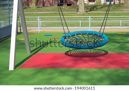 swing bench on a kids playground - stock photo