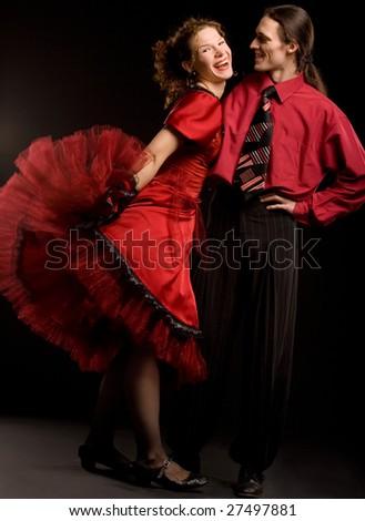 Swing dancers on black background - stock photo