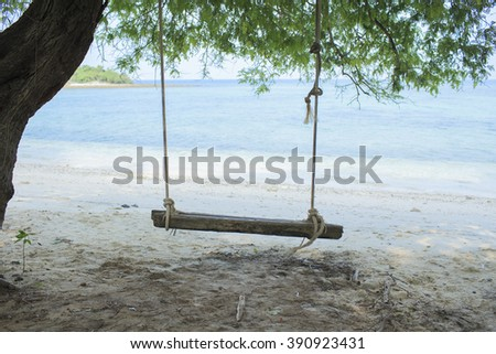 Swing hanging under the tree at Kho Kham Sattahip, Chonburi, Thailand - stock photo