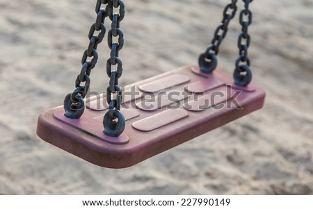 Swing in a park, playground for kids, selective focus - stock photo