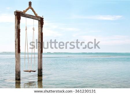 Swing in the sea - stock image - stock photo
