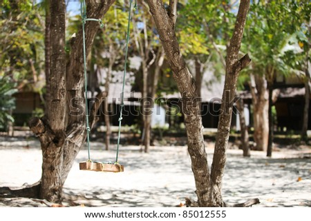 Swing on a tropical beach. - stock photo