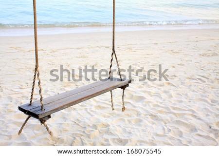 Swing on the beach. - stock photo