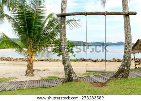 Swing on the beach  - stock photo