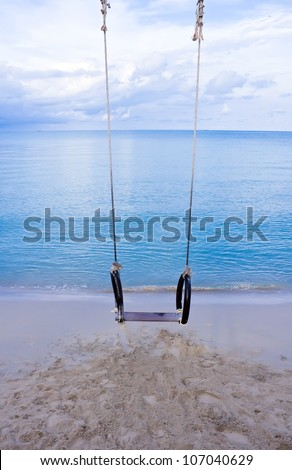 Swing on the beach in morning
