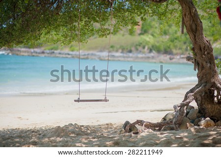 Swing on the white sand beach of Koh Larn Island, Pattaya, Thailand - stock photo