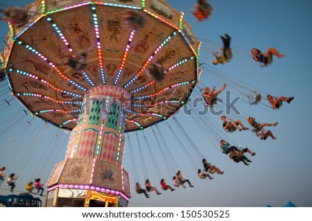 Swing ride at fair - stock photo
