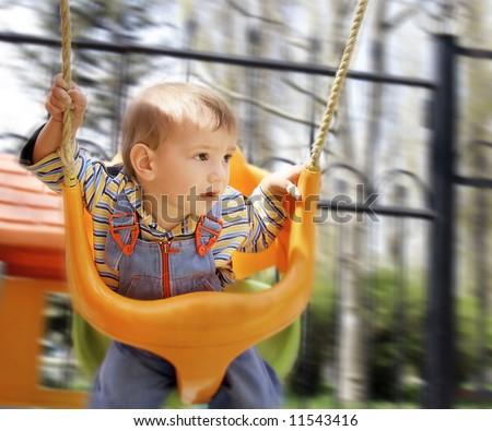swinging baby boy - stock photo