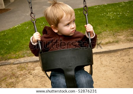 Swinging Boy - stock photo