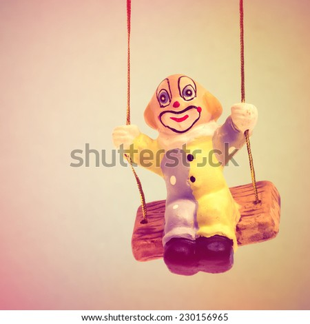 Swinging clown figurine with instagram effect - stock photo