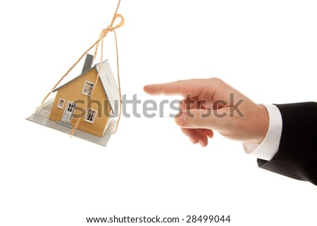 Swinging House and Business Man's Hand Reaching or Pushing Isolated on a White Background. - stock photo