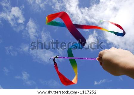 swinging the rainbow ribbon on the air - stock photo