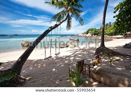 Swings and palm on the sand tropical beach. Kingdom Thailand - stock photo