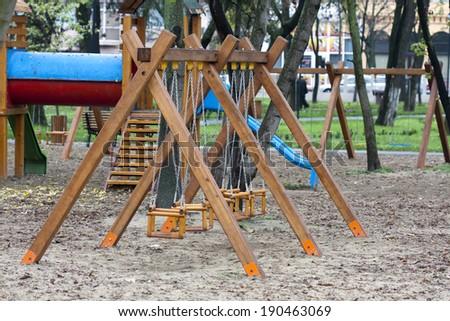 swings for children - stock photo