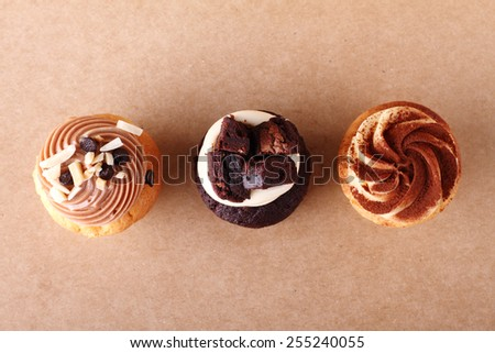 swirl icing topping of three cupcakes - stock photo