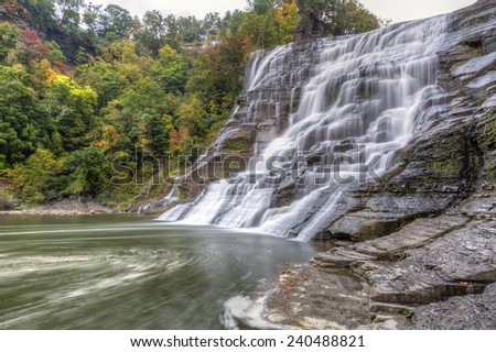 Swirling foam below powerful Ithaca Falls on Fall Creek, near the Cornell Campus in Ithaca, New York - stock photo