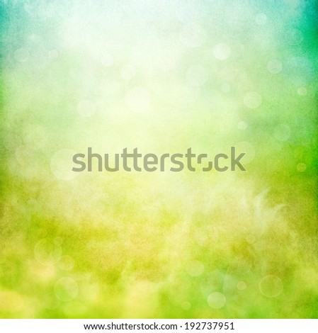 Swirling grunge patterns and textures with bokeh bubbles rising towards the sky.  Image displays a strong paper grain and texture at 100 percent. - stock photo