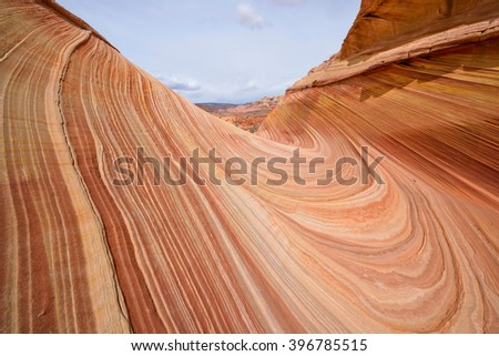Swirling Rock - Colorful and swirling sandstone rock formations at The Wave - a dramatic and colorful erosional sandstone rock formation located in North Coyote Buttes area at Arizona-Utah border.  - stock photo