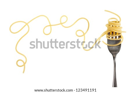 Swirls of cooked spaghetti with fork - stock photo