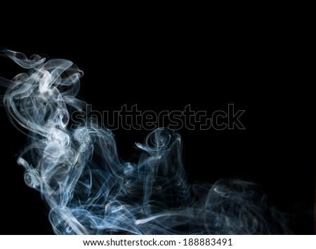 Swirls of smoke on a black background. - stock photo
