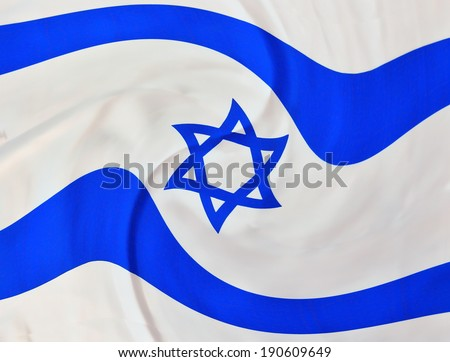 Swirly Israel flag in white and blue showing the Star of David hanging proudly for Israel's Independence Day (Yom Haatzmaut)