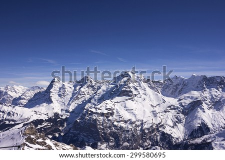 Swiss alps mountain in winter with clear blue sky