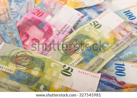 Swiss banknotes of 10, 20, 50, and 100 CHF bills