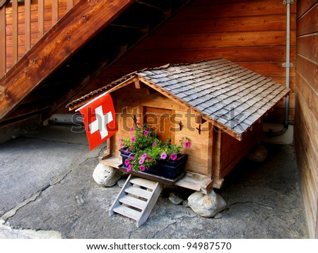 Swiss beauty, the house of proud swiss dog - stock photo