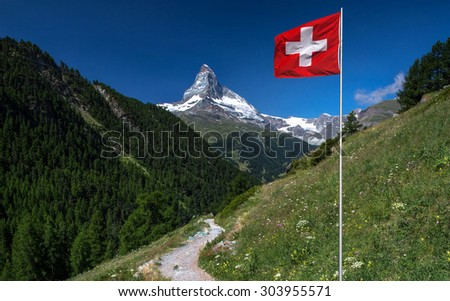 Swiss beauty, valley with flag under unbelievable Matterhorn