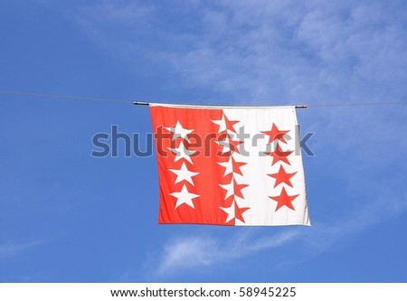 Swiss Canton Flag Series: Wallis; Valais: the 13 stars represent the 13 communes of the canton; the white and red are the traditional colors of Switzerland. - stock photo