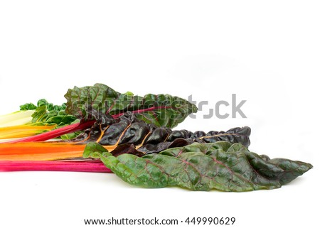 Swiss chard or silverbeet leaves in rainbow mixed isolated on white background - stock photo