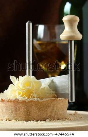 Swiss Cheese Specialty - Tete De Moine on the scraper Girolle, DOF on cheese - stock photo