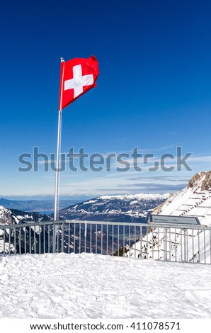 Swiss flag at the top of the mountain - stock photo