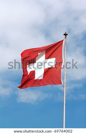 Swiss Flag swinging in the air - stock photo