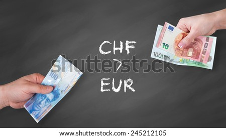Swiss Franc and Euro banknotes on black board - Swiss Franc is stronger than Euro - stock photo