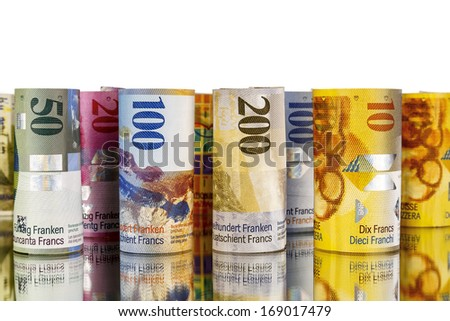 Swiss franc, banknotes rolled up in rolls with a mirror reflection, and on a white background - stock photo