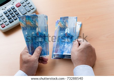 Swiss franc bills. Currency of Switzerland is counted by hand.