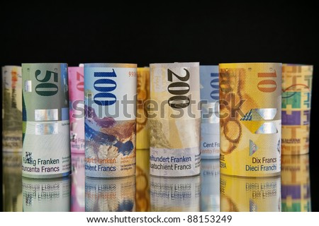 swiss franc rolls - stock photo