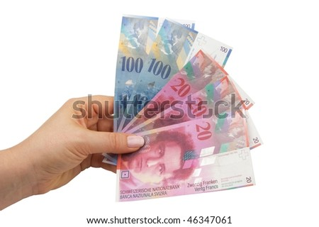 Swiss francs banknotes hold in female hand - stock photo