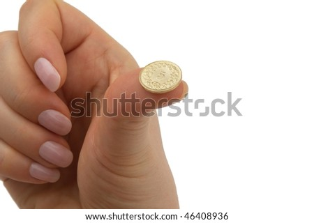 Swiss francs five centime coin on female thumb