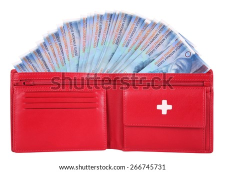 Swiss francs in red wallet - stock photo